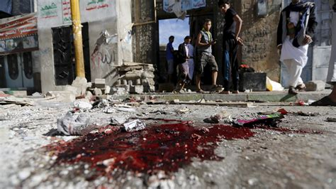Islamic State suicide bombers kill 10 at mosque prayers